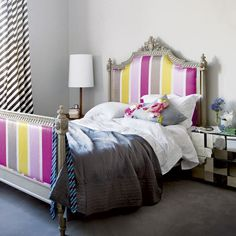 bold stripes in pink, grey and yellow / bedroom interior