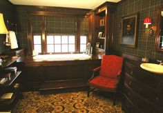 masculine bathroom with plaid walls, plaid Roman shades and dark wood paneling -- Di Biase Filkoff Architects P. C.