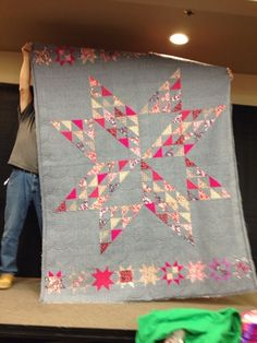 These quilts were show and tell quilts and I don't know the makers. It has been a while and so I don't remember much of the details on the...