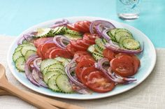 Tomato-Cucumber Salad recipe4 small  tomatoes, thinly sliced 2 small  cucumbers, thinly sliced 1 small  red onion, thinly sliced 1/2 cup  KRAFT Lite Zesty Italian Dressing