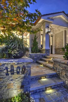 Entryway, stone entrance & lighted walkway