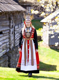 "Europe | Portrait of a Norwegian bride in wearing a wedding dress traditional 15th Century style called ""The Crowned Bride"", Norway"
