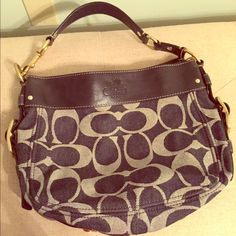 Coach Signature Zoe Shoulder Bag Coach Signature Zoe Shoulder Bag made from blue jean material, genuine leather and gold hardware. New without Tags... Never been used. Lovely lilac inner liner with two small pockets and large zipper pocket. Purse closes entirely with a zipper as well. Perfect for summer nights or transitioning into fall! Comes with two dust bags. Coach Bags Shoulder Bags