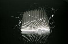 'Slice' - Annie Woodford - 2010  Porcelain, nylon mono-filament    16 x 12 x 20 cm