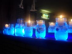 Creepy, glowing jars of eye balls & skulls!! Did you know Tonic water glows with a black light? Fill jars with tonic water & put in creepy items like plastic eye balls or skulls, then put a votive candle on top. Put the black light behind the jars to make glow.