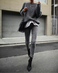 woman in black sweater, black leather crossbody bag, and grey d. woman in black sweater, black leather crossbody bag, and grey denim jeans walking on concrete pathw Fashion Mode, Look Fashion, Winter Fashion, Ladies Fashion, 90s Fashion, Fashion Trends, Street Fashion, Spring Fashion, Fashion Tips