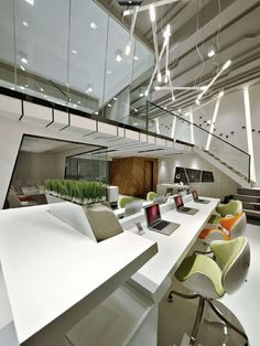 This seems like a really cool upbeat modern office space. Mixed feeling about those chairs, but they do look comfortable!