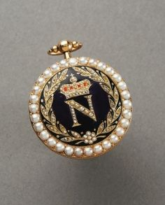 """Depicted in this picture is the lavish gold watch of the Emperor himself. The """"N"""" for Napoleon is crowned in pearls surrounded by laurel leaves."""