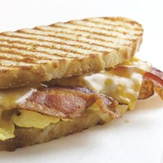 This delicious panini sandwich features three strips of smoky-sweet applewood bacon, farm-fresh eggs, and melted Colby Jack cheese on buttery-crisp grilled country bread.