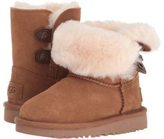 UGG Kids Maybin (Toddler/Little Kid) The adorable UGG Maybin boot is a must-have for your little one's winter wardrobe! ; Twinface sheepskin upper. ; Leather tab and snap closure. ; Nylon binding.