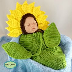 Crochet Newborn Sunflower Bonnet Hat with Cocoon Photo Prop Pattern by AMKCrochet.com. Leaves attached to the ties of the swaddle sack, to make a little baby sunflower.