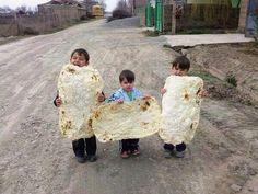 Armenian Boys eatin bread
