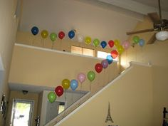 Happy birthday boyfriend! For my man's 26th birthday I tied 25 (was 26, but one popped!) balloons to the staircase. Attached to each balloon was one reason why I was glad he was born today.  On reason 26, since I didn't have another balloon, I placed an envelope with couple oriented coupons inside (breakfast in bed, sexy time, backrubs, etc). He loved it! :)
