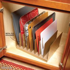 Instant Kitchen Cabinet Organizer - A metal file organizer is perfect for storing baking sheets, cutting boards and pan lids. You can pick one up for a buck at a dollar store. To keep the organizer fr(Baking Equipment Storage) Kitchen Cabinet Organization, Organization Hacks, Kitchen Storage, Organizing Ideas, Cabinet Ideas, Storage Cabinets, Kitchen Cabinet Liners, Baking Organization, Pantry Cabinets