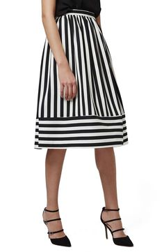 Make trend-right monochrome stripes an unexpected statement with this A-line skirt by Topshop.