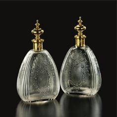 A pair of Tiffany 18k gold mounted glass scent bottles, Tiffany  Co., New York, circa 1900