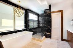 Zebrino Black and Gold Marble Bathroom | Aria Stone Gallery    #ariastonegallery #marble #blackmarble #bathroom #bathroomdesign #blackbathroom #marblebathroom #naturalstone #stoneisart #stoneart #interiordesignideas