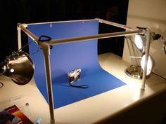 Turn a few lengths of PVC pipe and elbows into a cheap and effective photography light box