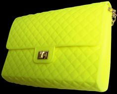 """Lemony Cricket Candy Bag   $95.00  www.ClassyChickClothingOnline.com  Recycled rubber handbags are the ultimate in recycled fashion for your eco-friendly lifestyle. The chain strap allows for over-the-shoulder or cross body styling. The studded enhancement of our original recycled rubber handbag adds that extra pop to your eco-friendly look.  H-6.75"""" (17.1cm) L-9"""" (22.7cm) W-2.5"""" (6.4cm)"""