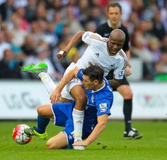 Everton's Gareth Barry tackles Swansea City's Andre Ayew.