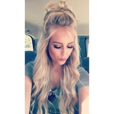 My recent discovery and love for this trendy half up half down braided bun has lead me to share with the world how easy and cute this is! I say don't knock i...