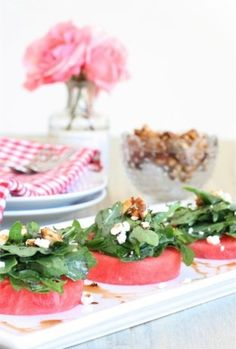 This watermelon salad with arugula, goat cheese, and candied walnuts is such a pretty dish to serve at a summer party.