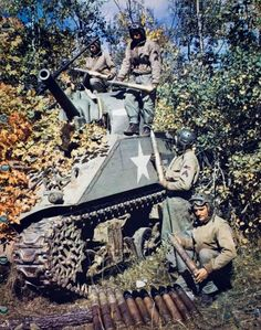 A US Sherman tank crew reloading their main gun.