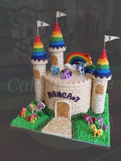 My Little Pony castle rainbow cake I made for a friend's daughter.