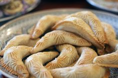 """""""qab ghrazal"""" (gazelle horn) pastries. Time consuming pastries made especially for weddings from a thin and flexible pastry filled with marzipan. Delicious  fancy corne de gazelle by Serenae on Flickr."""