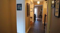 Hallway. Hardwood flooring. Central stairs.