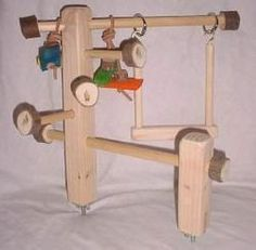 Double Mounted Cage Top Gym (mysafebirdstore.com) Would be really nice in the cage we are making for the cockatiels. Looks like pine 2x2s drilled for dowels.