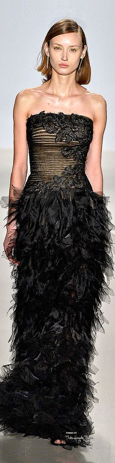 Such a beautiful strapless bronzed corset gown with black floral design and ruffled, sheer flowing skirt. Perfection for a ball/prom.