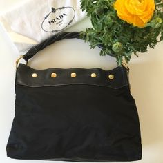 """Prada Tessuto Black Hobo In excellent pre-loved conditions. Little wear on nylon. No rips/tears. Black nylon Prada Tessuto hobo with vitello daino leather trim and single braided top handle. Gold tone hardware, interior zip pocket and top snap closure. Measurements: shoulder strap drop 5.5"""". Height: 11.5, Width: 15"""", Depth: 4"""". Prada Bags Hobos"""