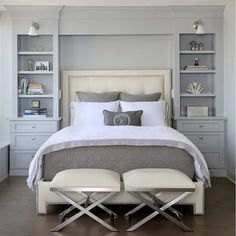 These floor to ceiling book shelves double as a storage and an eye- capturing focal point that surrounds the head board making the bed in this master bedroom the center of attention. Design by Chris Ebert @normandyremodeling    #bedroom #onetofollow #loveit #ilove #inspo #instahome #design #interiorinspiration #interior_design #designinspo #inspiration #interiorforinspo #instadaily #followme #interiorstyling#interiør #interior #instagood #interiordecoration #instaroom #roomforinspo  #follow…