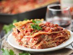 This hearty vegan lentil lasagna is made with layers of noodles, rich cashew ricotta and hearty mushrooms and lentils simmered in spicy tomato sauce.