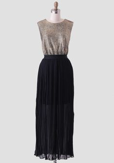 Elegant and flowy, this stunning maxi dress features a crackled design at the bodice in a gold hue and a black skirt with soft accordion pleats. Finished with an elastic waistband for a flatter...