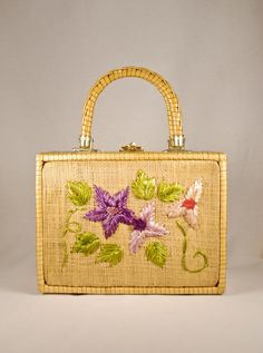 Vintage 50s 60s Mister Ernest Straw Box Purse Embroidered Raffia Flowers. $30.00, via Etsy.