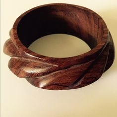 "Vintage Carved Wood Wide Bangle Bracelet A beautifully carved wide wood bangle bracelet in a deep brown grain. It measures approx. 4"" in outside diameter; 2-1/2"" inside opening.  In excellent preowned vintage condition. Smoke-free home. You may want to also take a look at my other wood bracelets for sale. Vintage Jewelry Bracelets"
