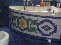 Old tub, mosaic tile matches wall tile