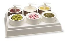 Carlisle Styrene White 6 Crock Coldcrock Organizer Only, 27.18 x 19.18 inch -- 1 each. Use with 2 qt Coldmaster® Coldcrocks to set up a condiment/topping station for salads, sandwiches, or desserts. 2 quart Coldcrock maintains 40°F or lower for eight hours (up to twelve hours with lid)*. Made of sturdy, high-impact plastic. Textured exterior hides scratches. CM1069 holds three CM1030 Coldcro... #Carlisle #Home