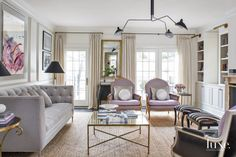 A designer injects a Parisian sensibility into her own Chicago home with chic furnishings and soft pops of color.
