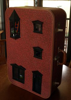 Well this just about rolls everything I adore into one perfect little package– miniature crafts, the golden age of travel and tiny fairy doors to another world. Marisa and David of Queanbeyan, Australia make dollhouses out of beautiful old suitcases they come across. They love to make old things new