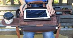Create your own office space anywhere with TaboLap laptop bag's built-in table surface and retractable shelves to store gadgets and drink cup.
