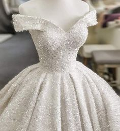 This off the shoulder #ballgown has #pretty sparkle. You can have this #weddingdress made as shown in any size. It can also be made in any colors. We are #American #weddingdress makers who specialise in totally #custom #weddingdresses for #brides of all shapes and sizes. We can make #replicas of #hautecouture #fashion #designs for less than the original. or you can consider a pre-made design from our catalog. Email sales@dariuscordell.com for more information & details.