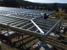 Installing the wrap around deck / verandah section of the steel frame kit.