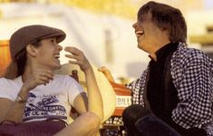 Carrie Fisher and Mark Hamill sharing laughs