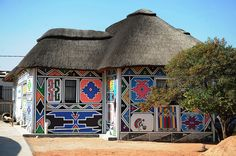 ndebele house, south africa Love the paint work they do to there homes