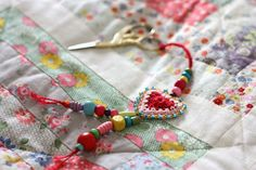 Love this little boho heart pincushion\key fob made by Cherry Heart. Link for her free pattern in post.