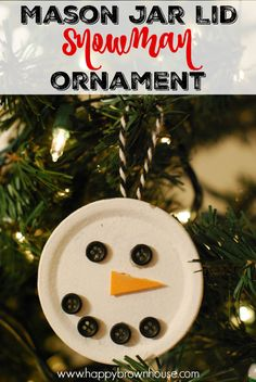 This adorable snowman ornament is made out of a canning or mason jar lid! What a clever idea. Mason Jar Lid Snowman Ornament made by kids.