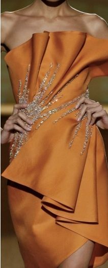 Fausto Sarli - The dress wrap around the body the echo the curves of the body; it moves the eye and attracts it.